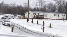 Police vehicles are seen outside a residence in Upper Big Tracadie, N.S., on Jan. 4, 2017. (Andrew Vaughan/THE CANADIAN PRESS)