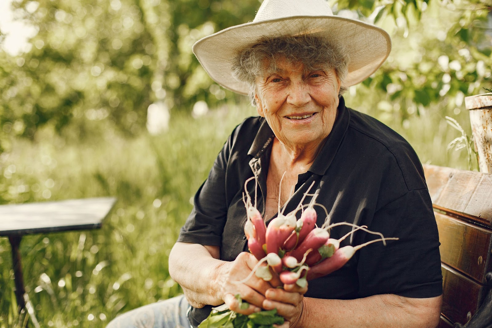 old-woman-holding-freshly-picked-radishes