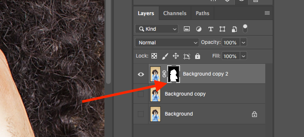 Layer mask in Layers Panel indicated with red arrow