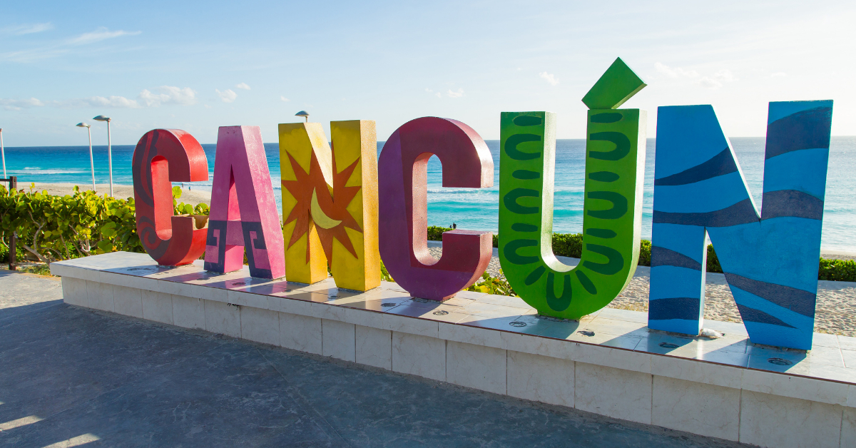 Cancun sign in front of the beach