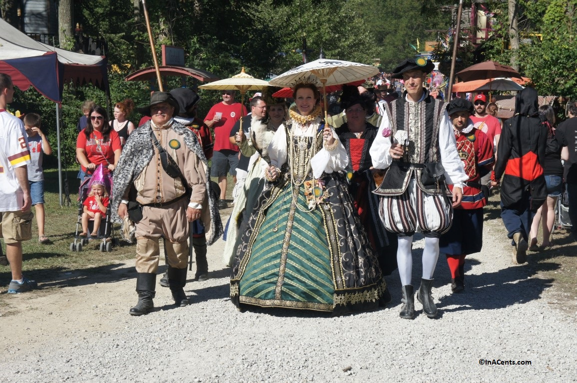 people dressed in renaissance costumes at a renaissance festival