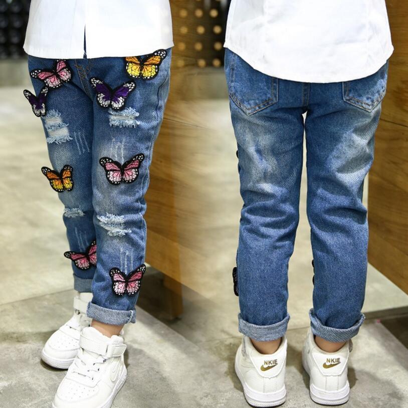 Spodnie z dziurami dla dziewczynki