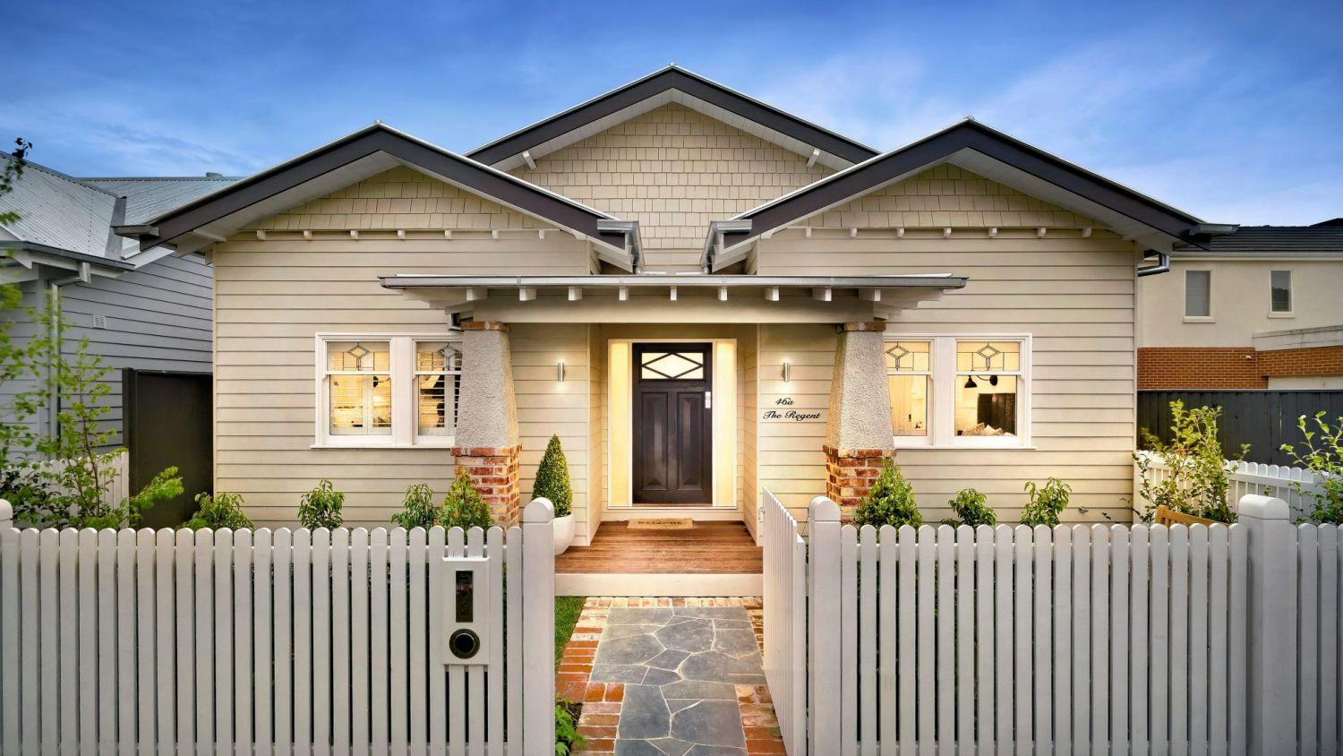 Single detached home with white picket fence