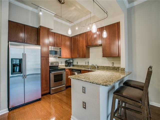 A gorgeous kitchen with upgraded appliances and countertops.