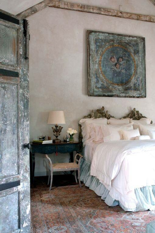 A Blue Shabby Chic Artwork Above the Bed