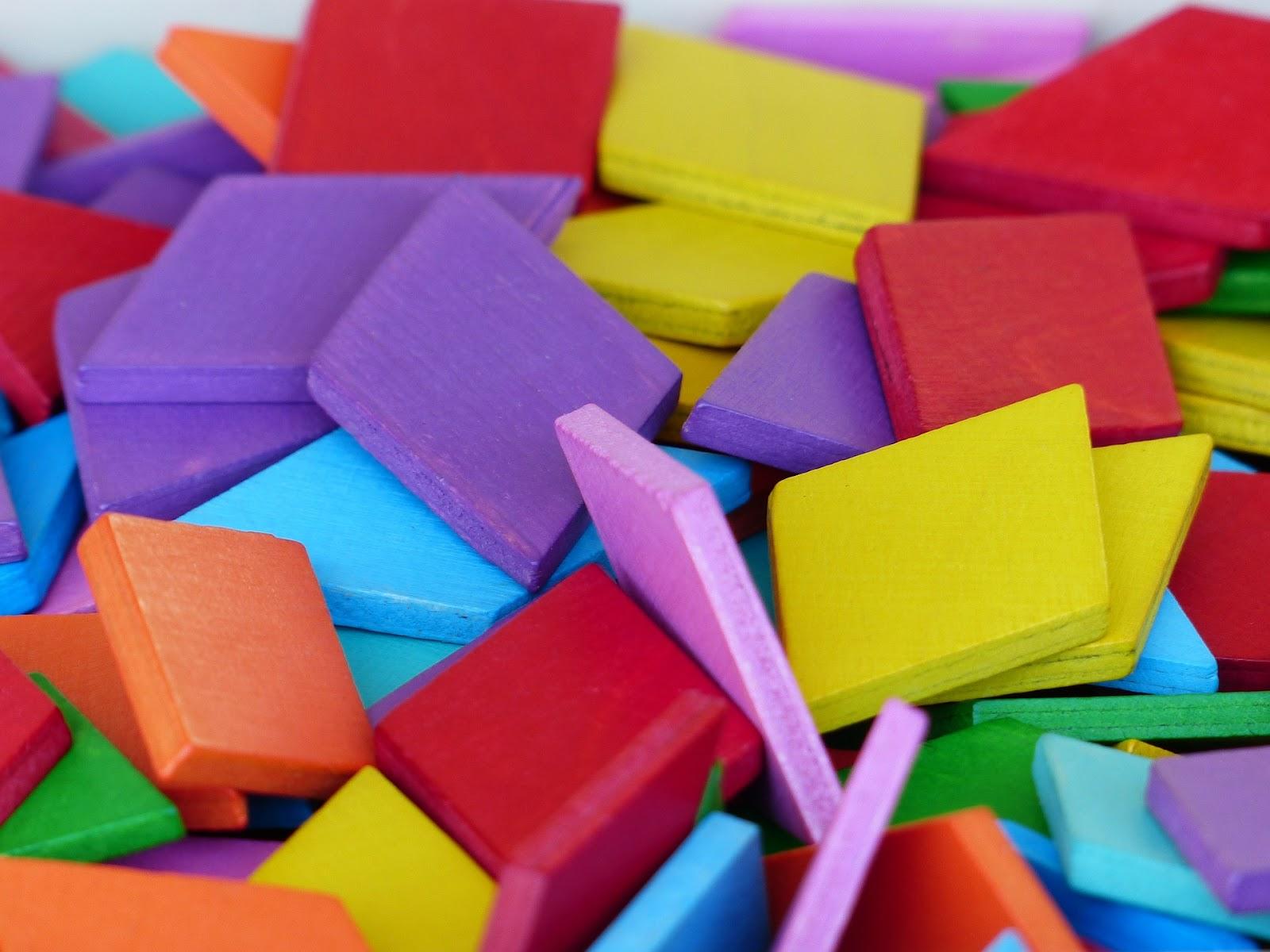 Multicolored, square wooden blocks.