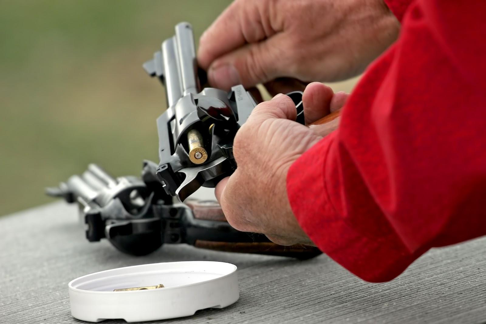 man unloading pistol