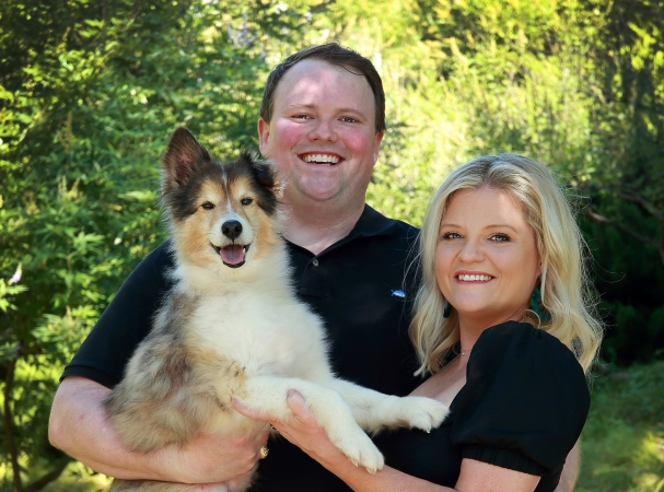 Fort Worth, TX realtor Adrianne Holland with her husband and their rescue dog