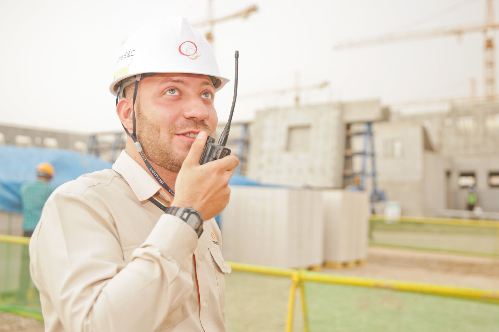 man in a white hard hat on a mobile device example of recruitment experience