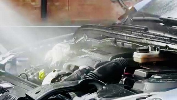 A car engine's being washed by water