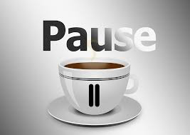 Pause button over cup of coffee