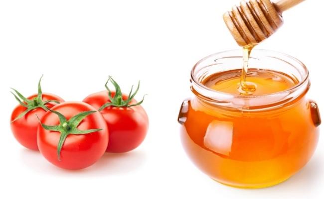 Cách làm trắng da mặt bằng mật ong và cà chua.jpg
