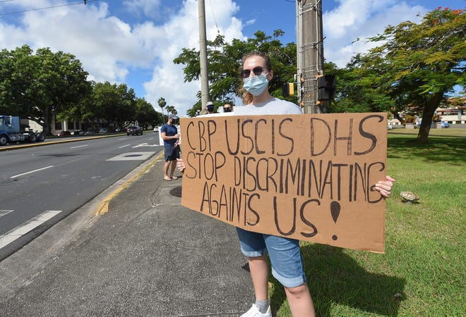 Ekaterina Usova protests with other Russian asylum seekers at the Paseo Loop in Hagåtña on Nov. 14, 2020.