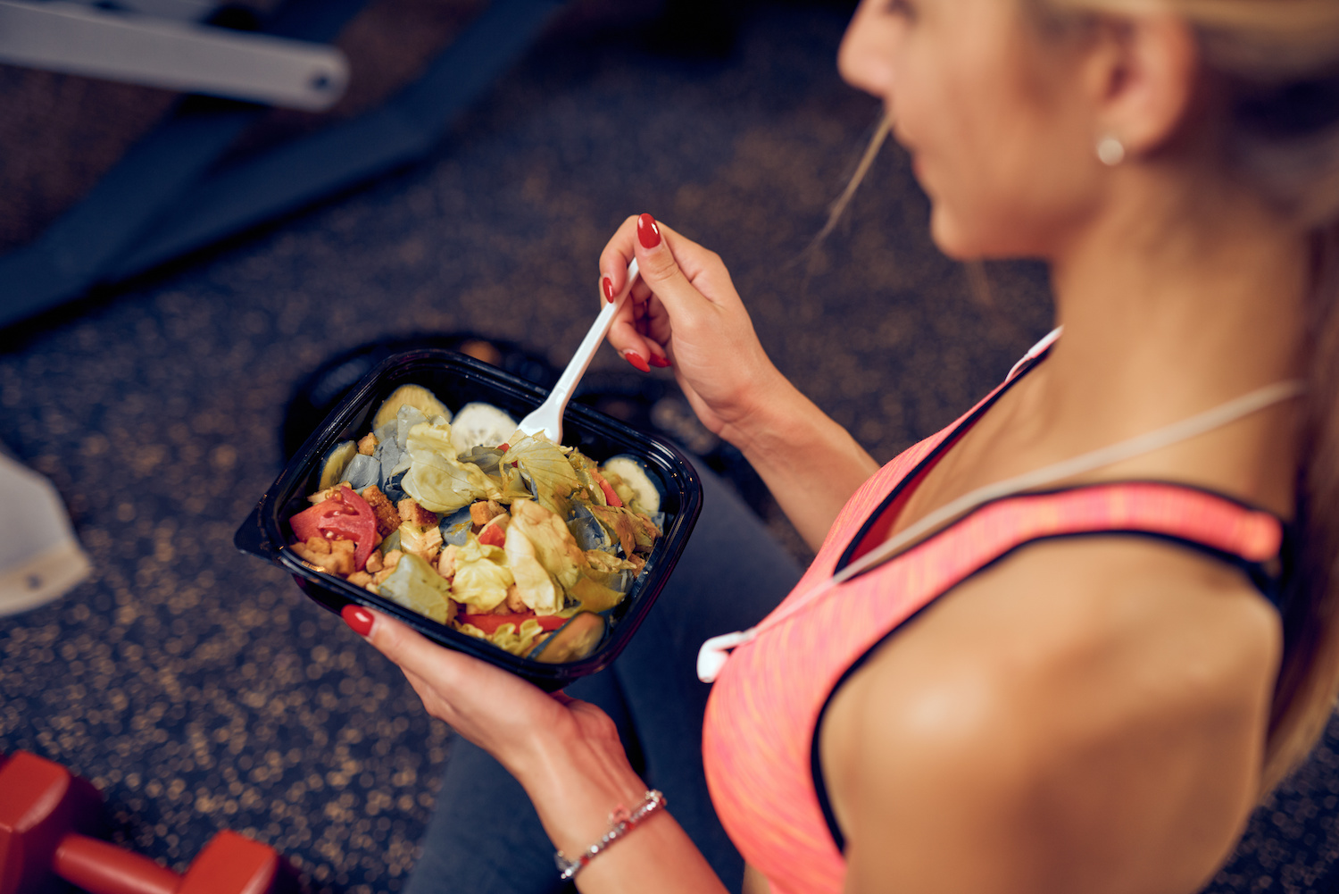 Woman eating meal prepared by a nutrition coach