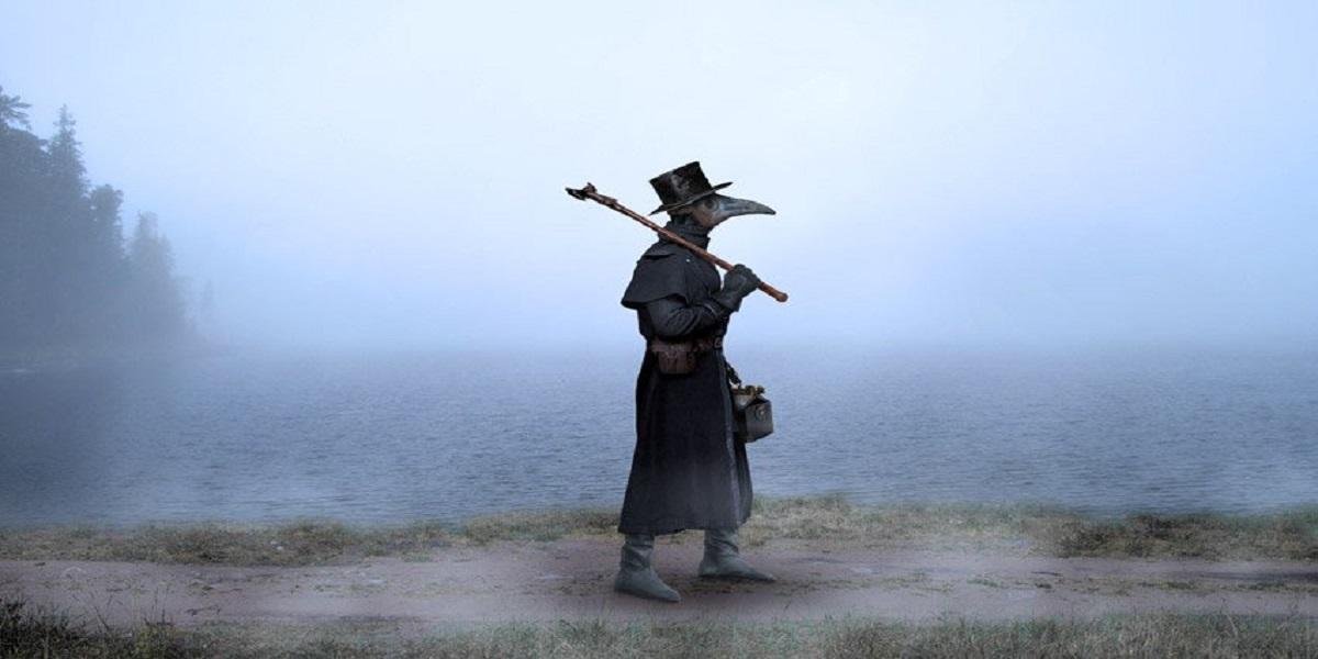 Homem em pé em frente a água  Descrição gerada automaticamente