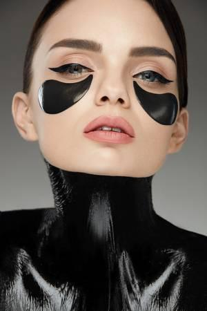 85441163-face-care-woman-with-patches-on-skin-under-eyes-beautiful-fashionable-female-with-black-under-eye-pa