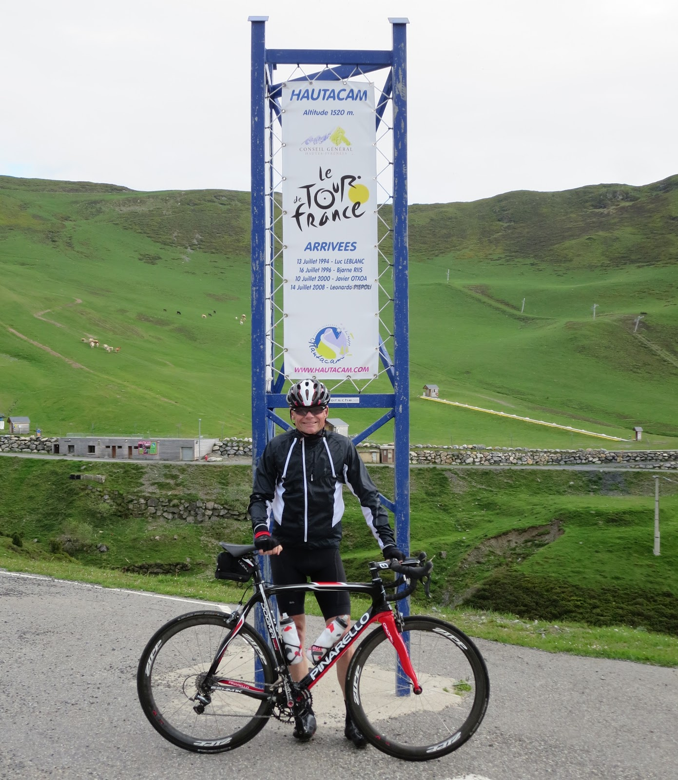 John Johnson with bike on Hautacam - Tour de France sign