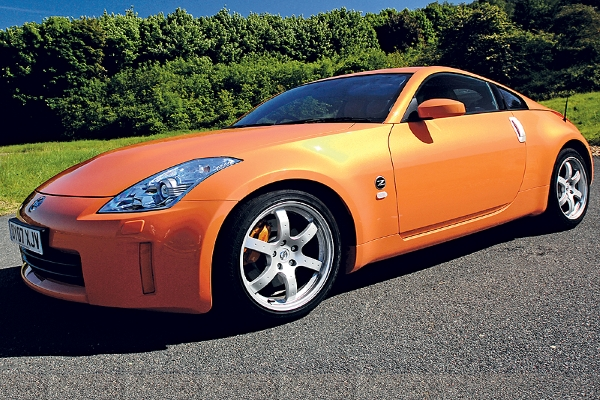It's not easy to find a used-yet-new outstanding Sunset Orange Nissan 350Z nowadays.