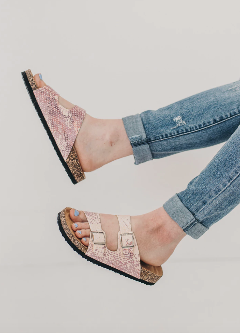 Open toed sandals with buckle strap detail.
