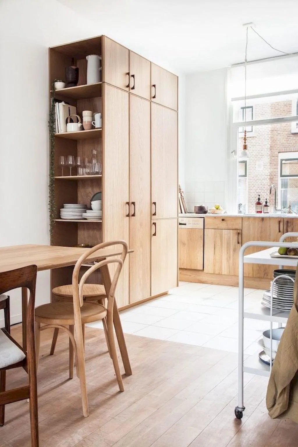 minimalist kitchen design with natural wood cabinets, wood floors and wood dining table