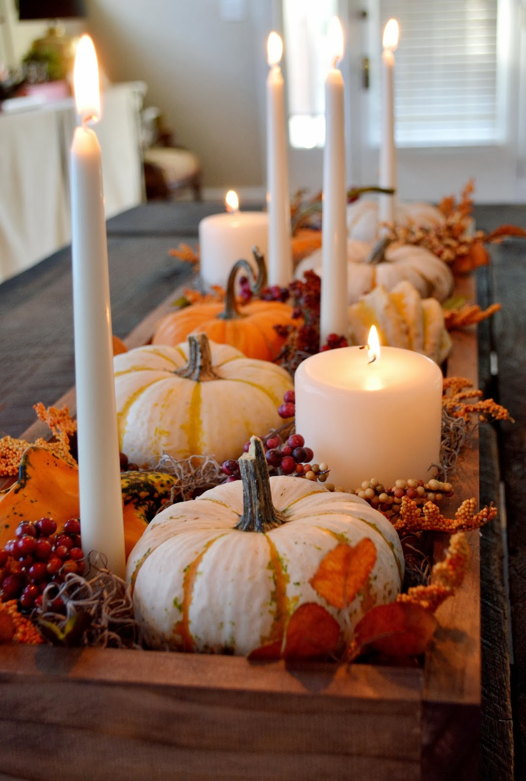 Danish taper candles and pillar candles with fall ornaments