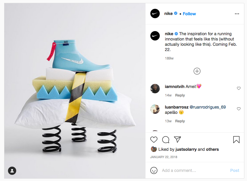 """Nike's Instagram showing a picture of a blue foot, four pillows held together with construction tape, and three springs. Caption reads: """"The inspiration for a running innovation that feels like this (without actually looking like this). Coming Feb 22."""""""