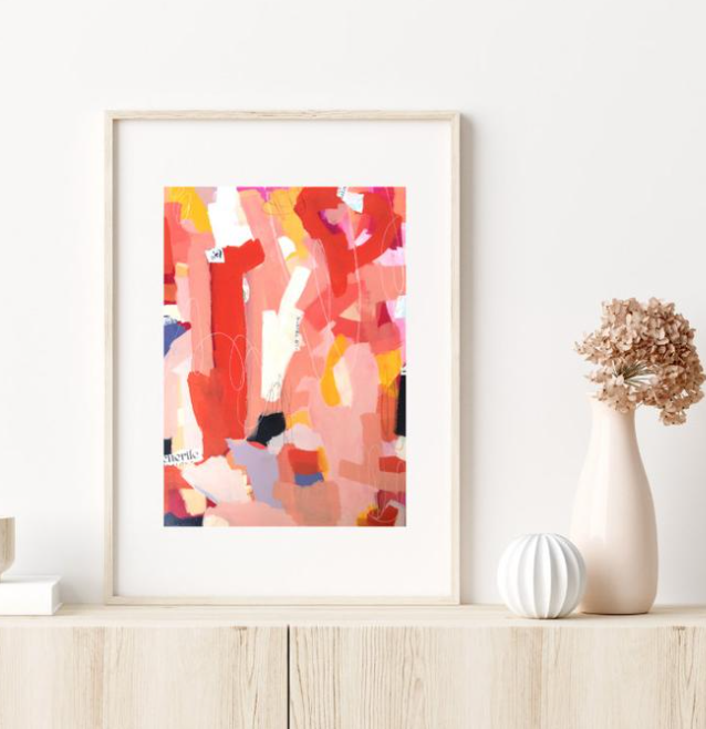 abstract pink and red painting for home office against neutral background