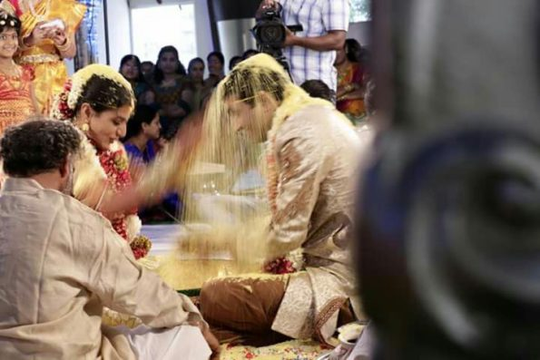 Rice being showered on the groom