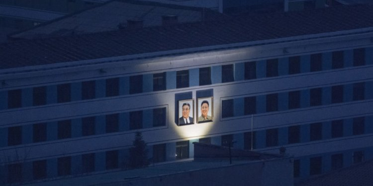 North Korea portraits electricity building