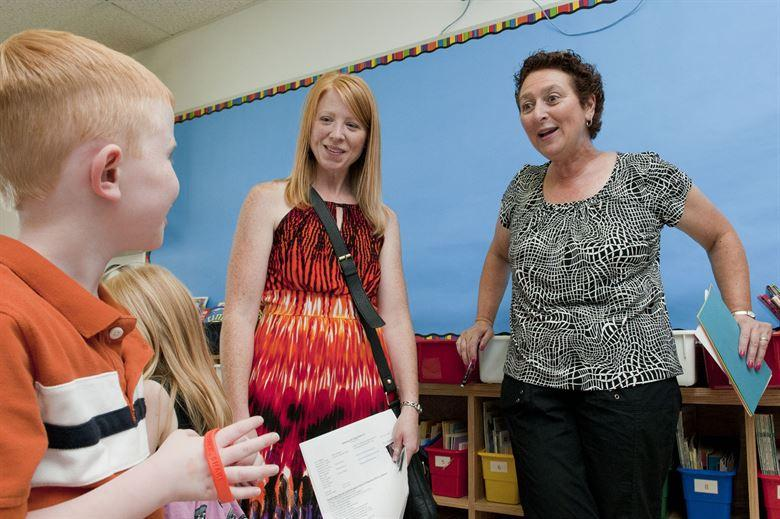 "Carol Mahn (right), a first grade teacher at the Hanscom Primary School, meets Melissa Weyand and her son, Maximas, during a ""Meet and Greet"" at the school Aug. 30. The primary and middle schools hosted the event as a way for parents and students to meet teachers, check class lists, purchase school spirit wear and find out more about the Parent Teacher Organization before the start of the new school year."