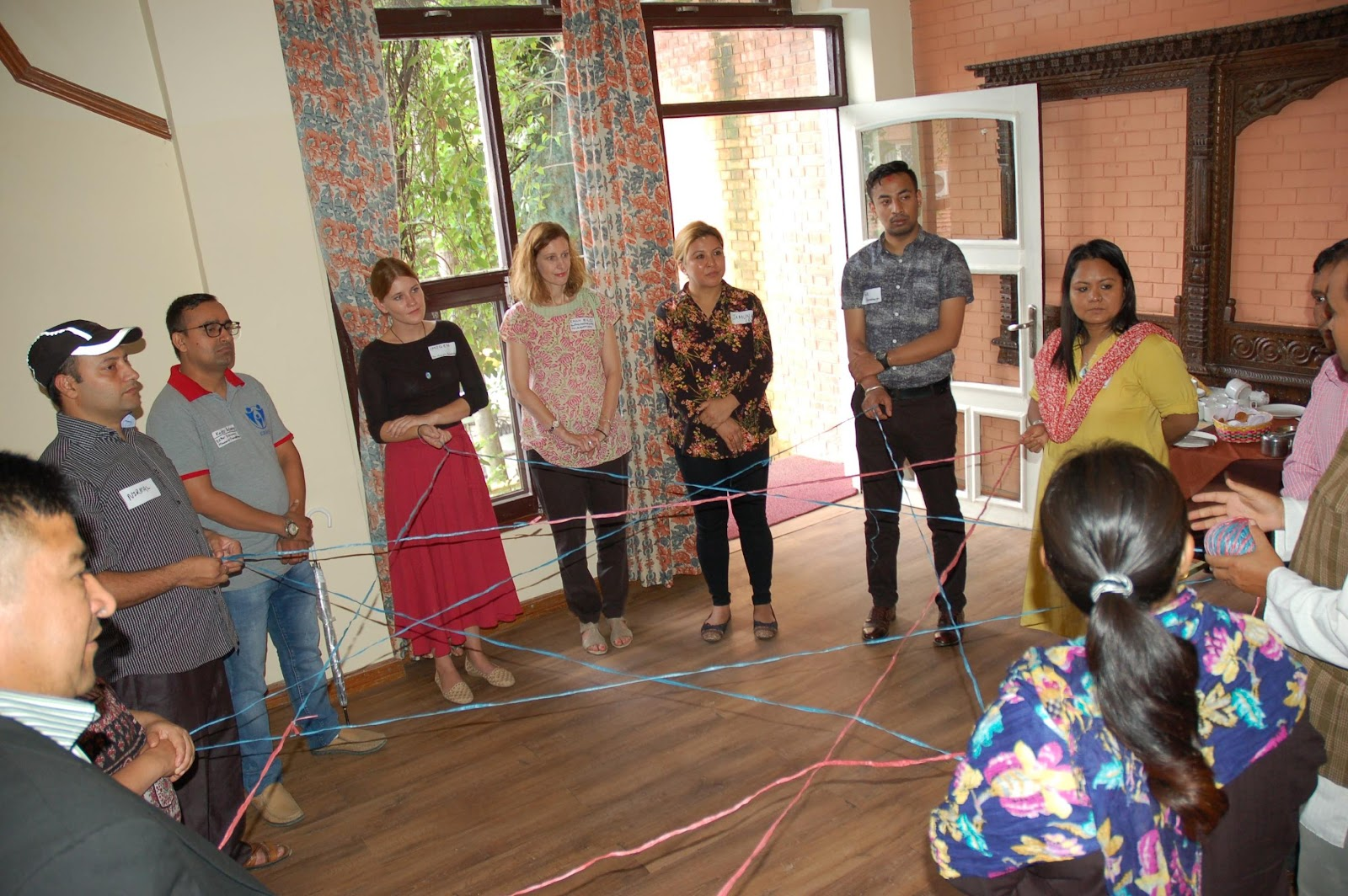 spider web ice breaker to demonstrate the power of collaboration