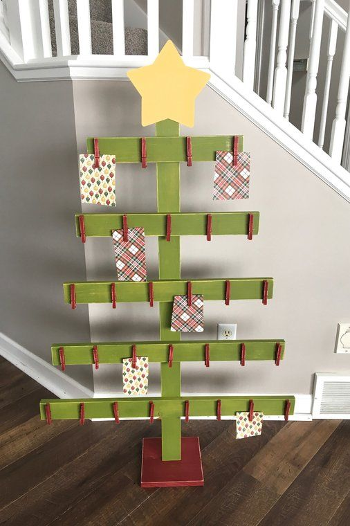 Wooden Christmas Tree Card Holder: These 25 DIY Christmas Card Holders - That Double As Festive Decor will allow you to beautifuly display your cards and will also give you some great decor.