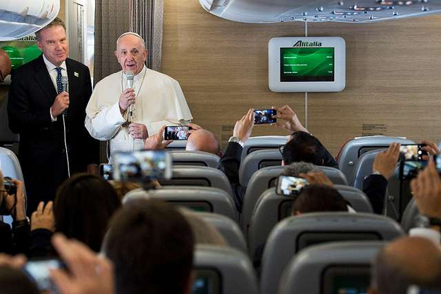 Pope Francis speaks to journalists aboard the flight from Rome to Bogota, Sept. 6, 2017. Credit: L'Osservatore Romano.