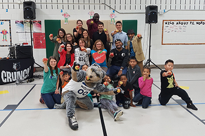 Students and staff from Farnsworth Elementary School in St. Paul hosted Crunch, the Timberwolves mascot for the Great Lakes Great Apple Crunch in 2017.