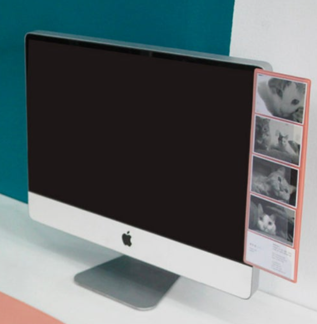 pink memo board attached to apple monitor computer on desk