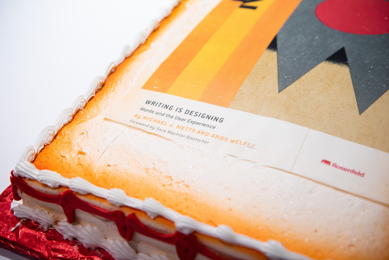 A cake decorated with the cover art of Andy Welfle and Michael Metts' new book, Writing is Designing: Words and the User Experience.