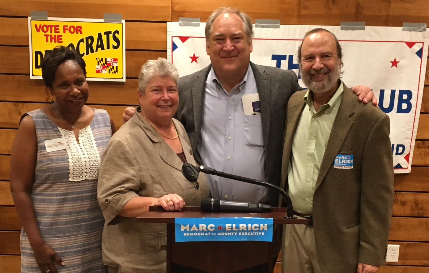 Four people stand together including Charlotte Crutchfield, Bonnie Cullison, Marc Elrich
