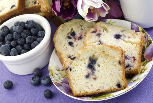 bowl of blueberries and plate of blueberry bread