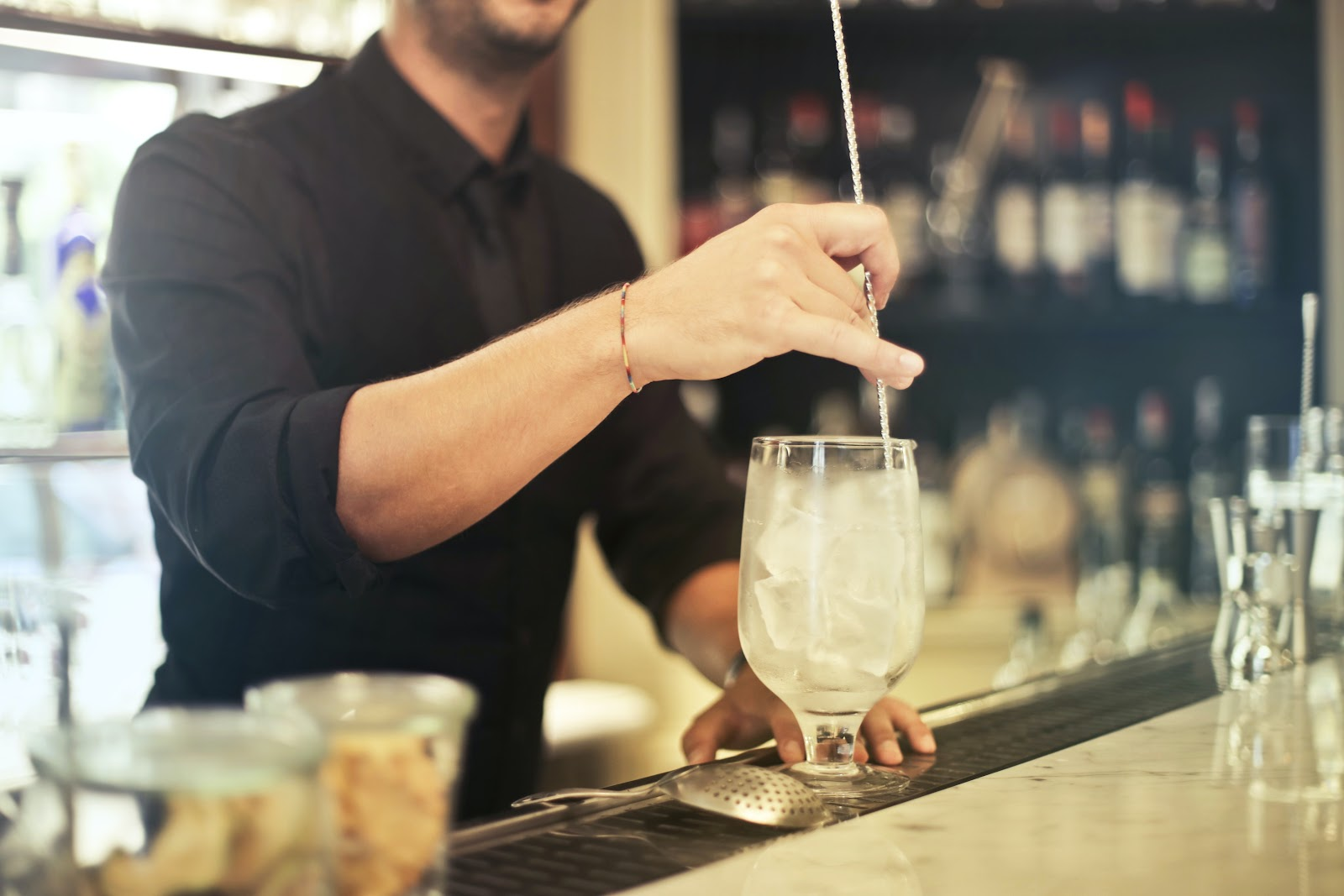 man-in-black-polo-shirt-holding-clear-drinking-glass-benefits wearing uniforms