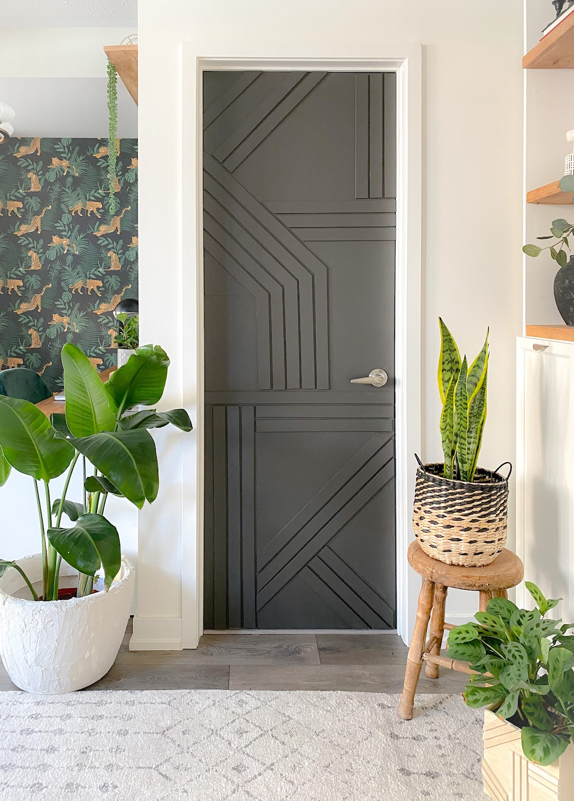 DIY modern barn door. The colour black works great with the leopard wallpaper in the background