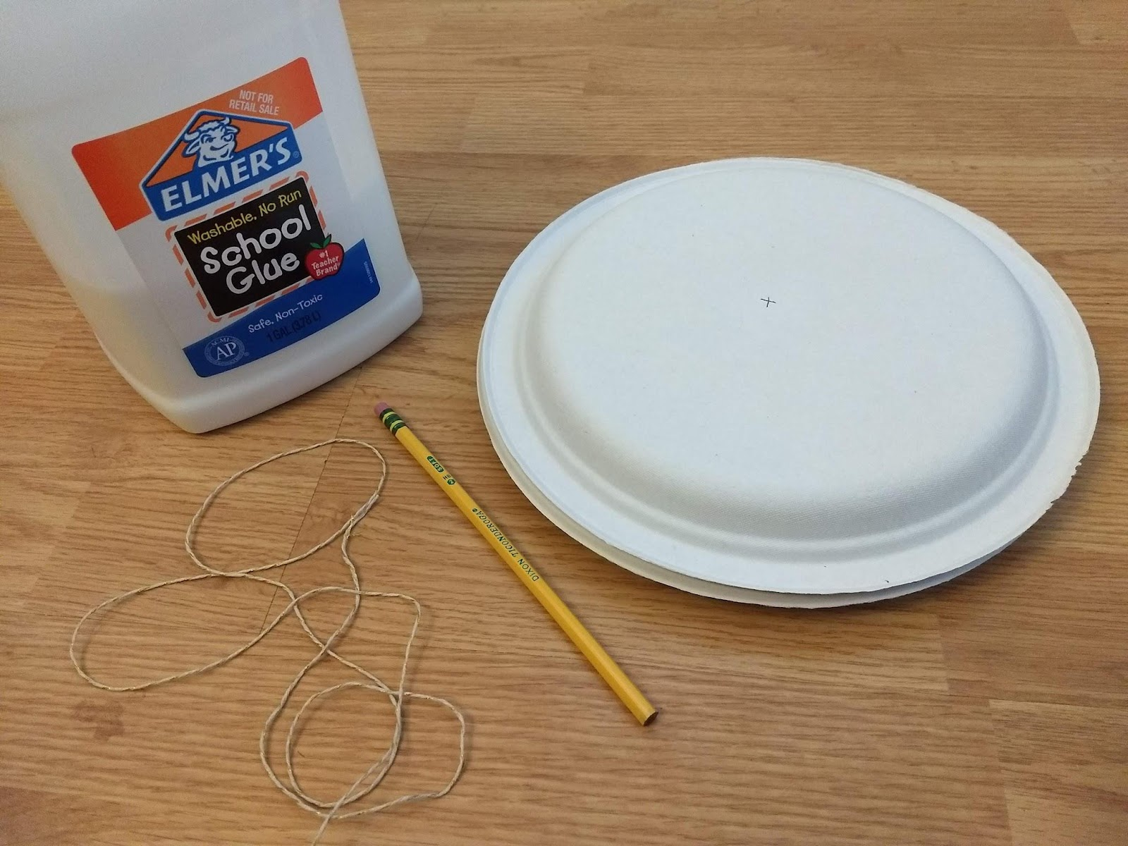 Elmer's glue, a pencil, two paper plates, and the string to pull your wheel and axle.
