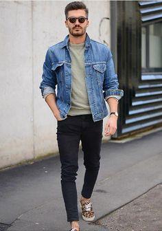 man in dark pants and denim jacket
