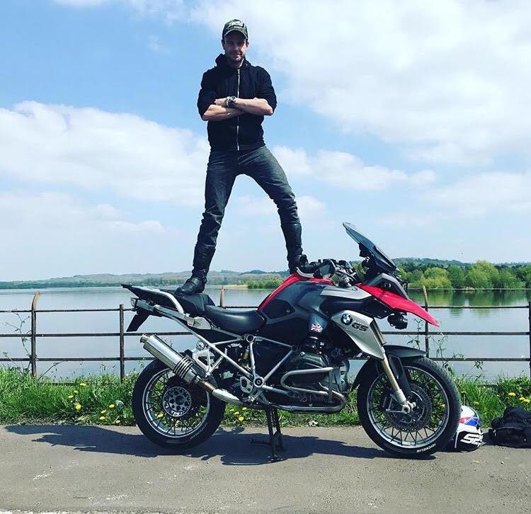 Nick standing on his Aprilia RSV1000