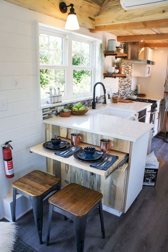 bright modern tiny home kitchen design with white countertops, modular furniture, natural light, open shelving, tile backsplash, shiplap walls, tiny house kitchen ideas like hgtv tiny homes