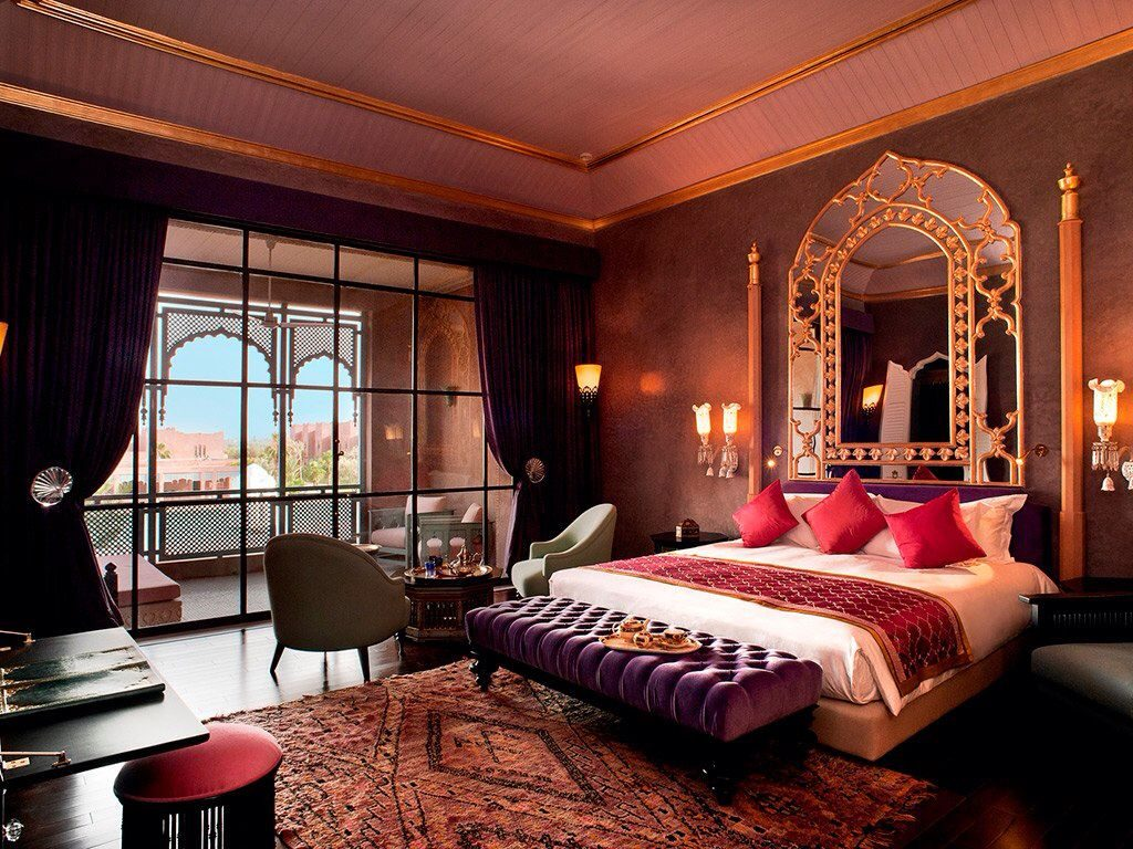 Gold Mirror Above the Bed