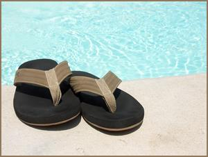 http://tailorsbunion.com/wp-content/uploads/2012/07/flip-flops-foot-health.jpg