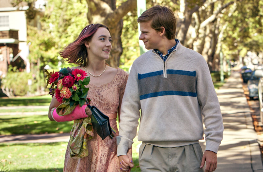 """Image of a boy and girl holding hands from the movie """"Lady Bird"""""""