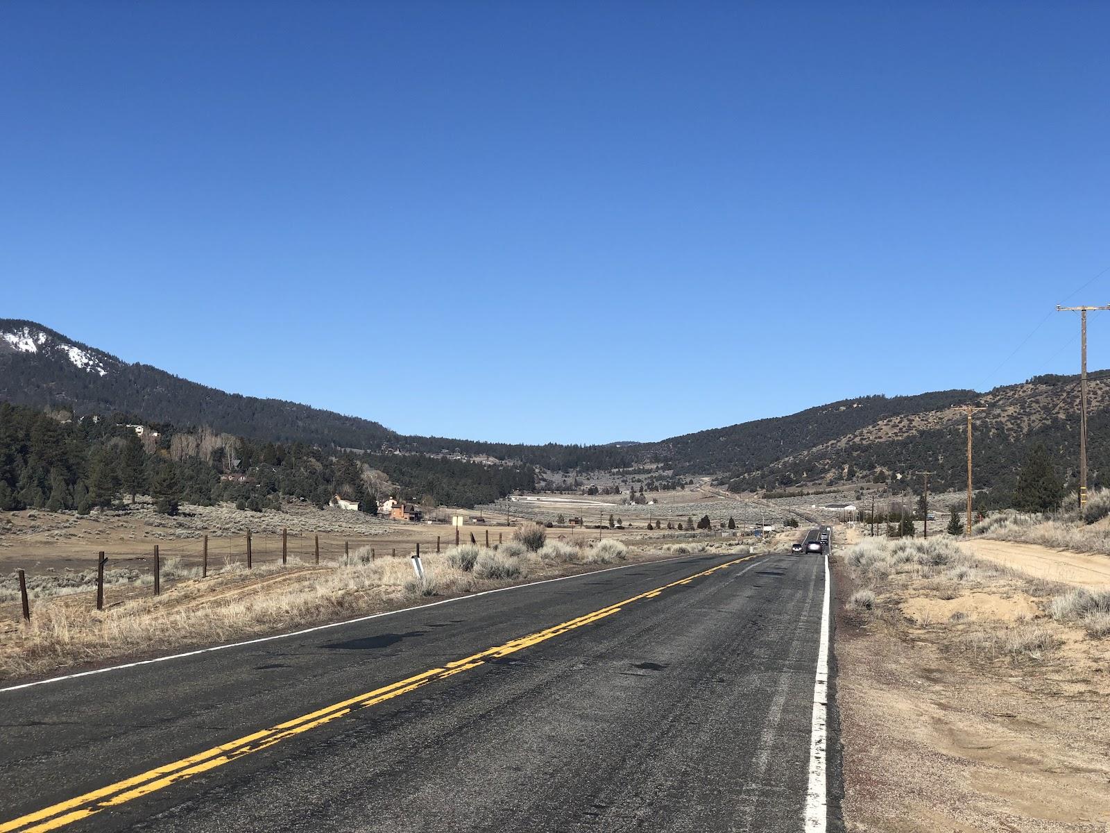 Bike climb Mt. Pinos - Cuddy Road, mountains behind