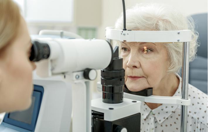 a senior woman getting an eye exam