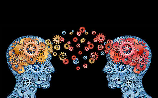 illustration of two human heads made of small colourful cogs, there are cogs between the two heads meant to indicate a sharing of ideas